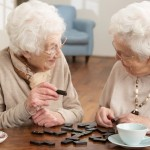 two elderly woman having tea together