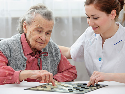 elderly woman playing chess with her inhome caregiver-11-20