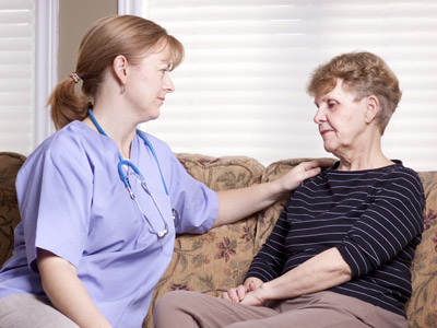 elderly woman and her in home caregiver discussing the options of respite care-kinship