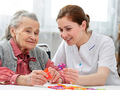 Woman Playing a Game with Her Caregiver