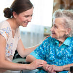 Elderly Woman Being Taken Care of By Caregiver with Senior Care