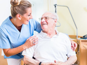 Caregiver providing excellent care to elderly man