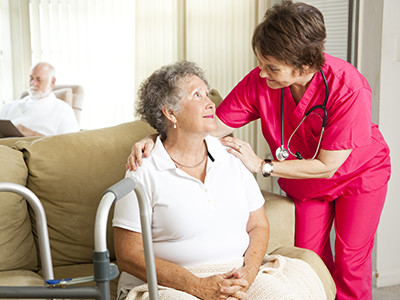 Elderly Woman being taken care of by her in home care
