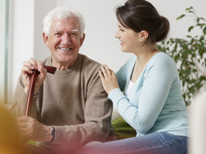 In Home Care Provider Is Supporting Elderly Man