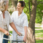Woman-helping-elderly-woman-with-walker